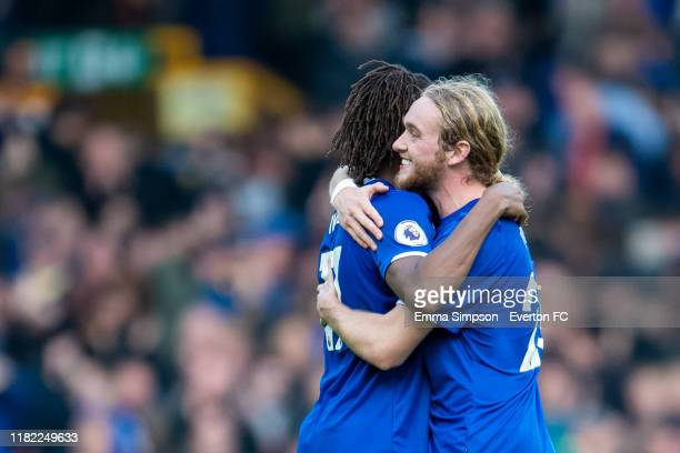Alex Iwobi and Tom Davies of Everton embrace at the end of the Premier League match between Everton FC and West Ham United at Goodison Park on...