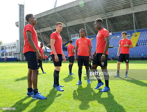 Alex iwobi Ben Sheaf Kaylen Hinds and Marc Bola of Arsenal check out the pitch before the UEFA Youth League match between GNK Dinamo Zagreb and...