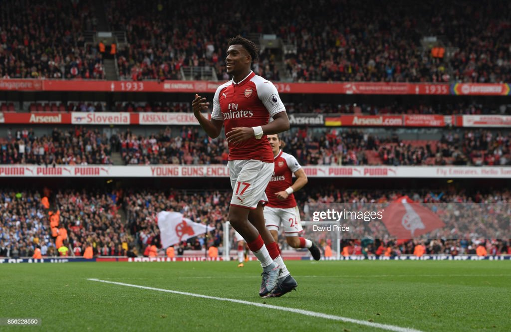 Alex Iwobi celebrates scoring Arsenal's second goal during the Premier League match between Arsenal and Brighton and Hove Albion at Emirates Stadium on October 1, 2017 in London, England.