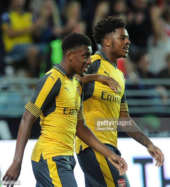 Alex Iwobi celebrates scoring his 1st goal with Chuba Akpom during the match between Viking FK and Arsenal at Viking Stadion on August 5 2016 in...