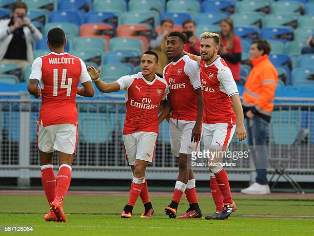Alex Iwobi celebrates scoring the 1st Arsenal goal with Aaron Ramsey Alexis Sanchez and Theo Walcott during the pre season friendly between Arsenal...