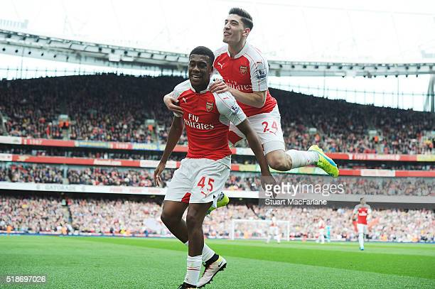Alex Iwobi celebrates scoring the 2nd Arsenal goal with Hector Bellerin during the Barclays Premier League match between Arsenal and Watford at...