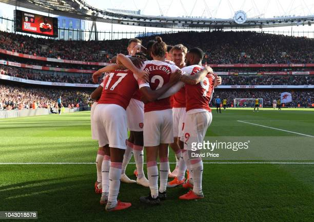 Alex Iwobi Hector Bellerin and Alexandre Lacazette celebrate scoring Arsenal's 1st goal with with his team mates during the Premier League match...