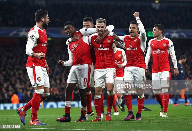Alex Iwobi of Arsenal Aaron Ramsey of Arsenal and Alexis Sanchez of Arsenal celebrate their sides second goal with their Arsenal team mates after...
