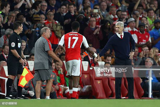 Alex Iwobi of Arsenal and Arsene Wenger Manager of Arsenal shake hands after he is subbed during the Premier League match between Arsenal and Chelsea...