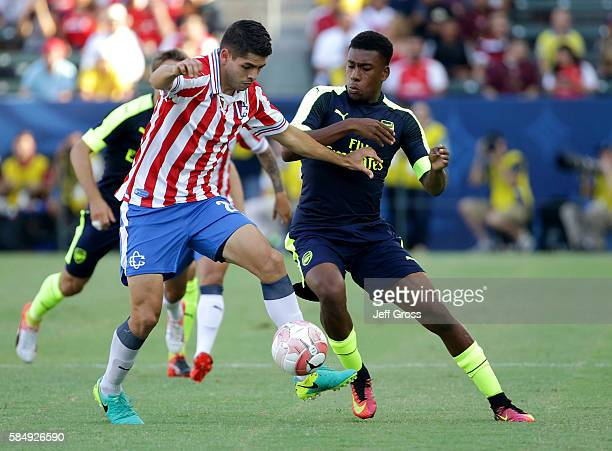 Alex Iwobi of Arsenal and Carlos Villanueva of Chivas de Guadalajara fight for the ball in the first half at StubHub Center on July 31 2016 in Carson...
