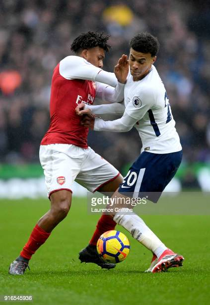 Alex Iwobi of Arsenal and Dele Alli of Tottenham Hotspur battle for the ball during the Premier League match between Tottenham Hotspur and Arsenal at...