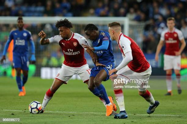 Alex Iwobi of Arsenal and Fousseni Diabate of Leicester City and Aaron Ramsey of Arsenal during the Premier League match between Leicester City and...