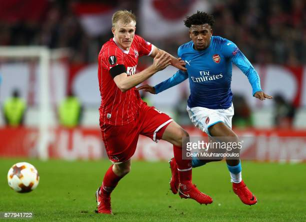 Alex Iwobi of Arsenal and Frederik Sorensen of FC Koeln battle for possession during the UEFA Europa League group H match between 1 FC Koeln and...