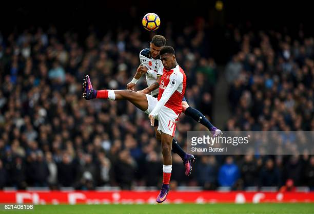 Alex Iwobi of Arsenal and Kyle Walker of Tottenham Hotspur in acton during the Premier League match between Arsenal and Tottenham Hotspur at Emirates...