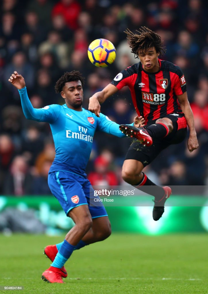Alex Iwobi of Arsenal and Nathan Ake of AFC Bournemouth battles for possesion in the air during the Premier League match between AFC Bournemouth and Arsenal at Vitality Stadium on January 14, 2018 in Bournemouth, England.