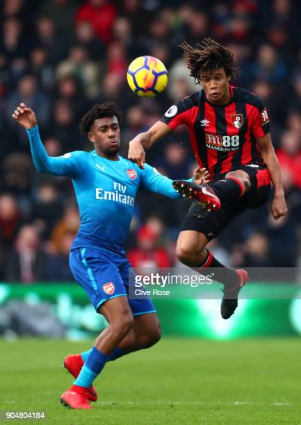 Alex Iwobi of Arsenal and Nathan Ake of AFC Bournemouth battles for possesion in the air during the Premier League match between AFC Bournemouth and...