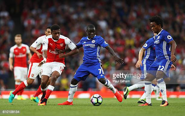 Alex Iwobi of Arsenal and N'Golo Kante of Chelsea battle for possession during the Premier League match between Arsenal and Chelsea at the Emirates...