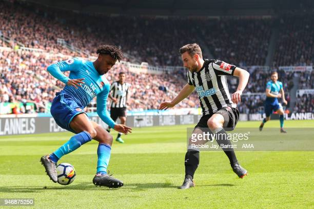Alex Iwobi of Arsenal and Paul Dummett of Newcastle United during the Premier League match between Newcastle United and Arsenal at St James Park on...