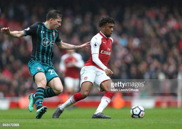 Alex Iwobi of Arsenal and Pierre Emile Hojbjerg of Southampton during the Premier League match between Arsenal and Southampton at Emirates Stadium on...