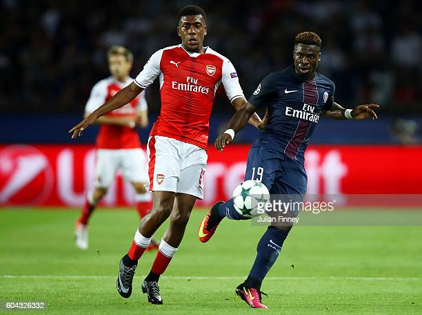 Alex Iwobi of Arsenal and Serge Aurier of PSG in action during the UEFA Champions League Group A match between Paris SaintGermain and Arsenal FC at...