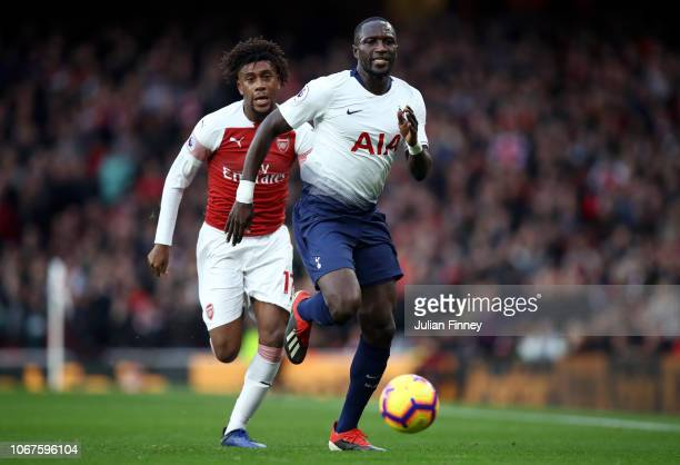 Alex Iwobi of Arsenal battles for possession with Moussa Sissoko of Tottenham Hotspur during the Premier League match between Arsenal FC and...