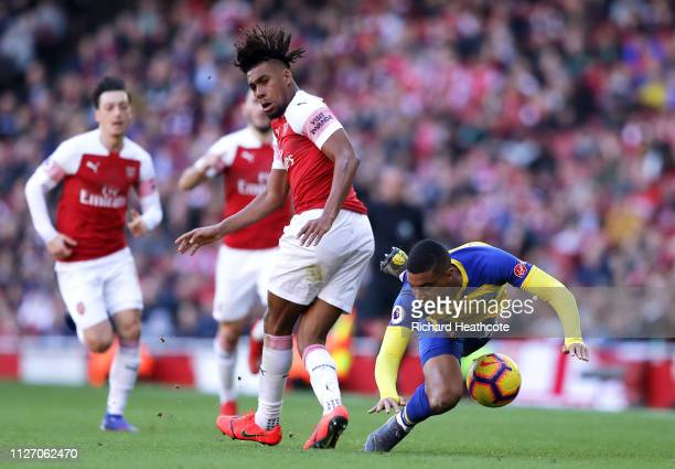 Alex Iwobi of Arsenal battles for possession with Yan Valery of Southampton during the Premier League match between Arsenal FC and Southampton FC at...