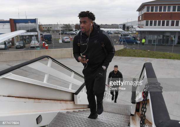 Alex Iwobi of Arsenal boards the plane at Luton Airport on November 22 2017 in Luton England