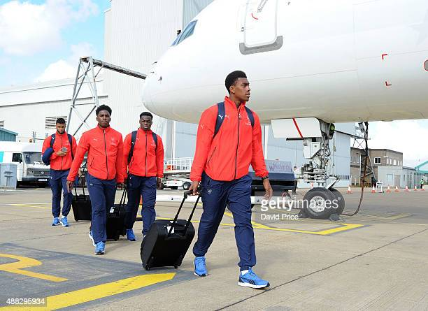 Alex Iwobi of Arsenal boards the plane for the flight to Zagreb ahead of their UEFA Champions League match against Dinamo Zagreb on September 15 2015...
