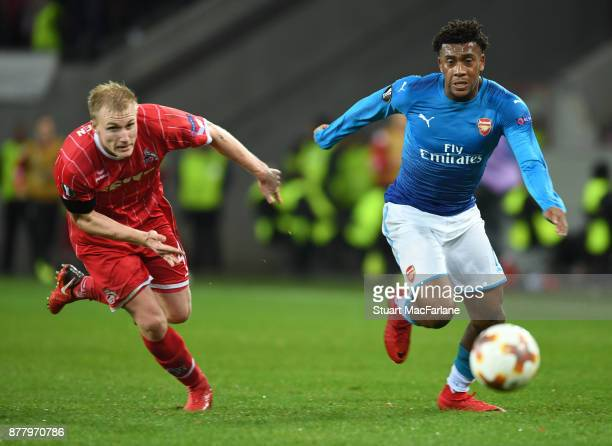Alex Iwobi of Arsenal breaks past Frederik Sorensen of Cologne during the UEFA Europa League group H match between FC Koln and Arsenal FC at...