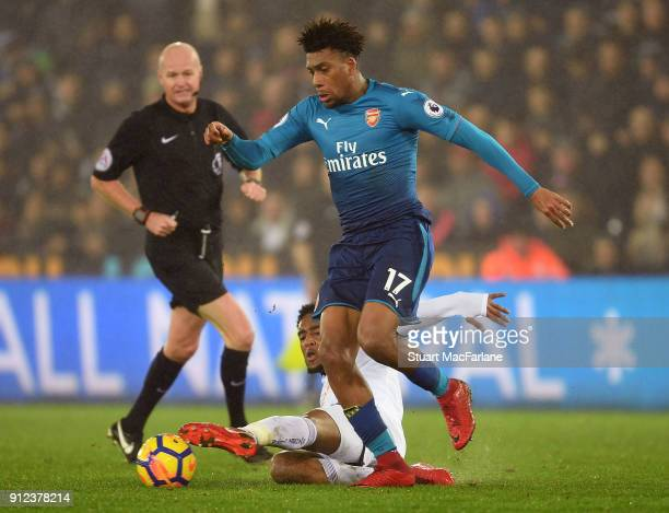 Alex Iwobi of Arsenal breaks past Leroy Fer of Swansea during the Premier League match between Swansea City and Arsenal at Liberty Stadium on January...
