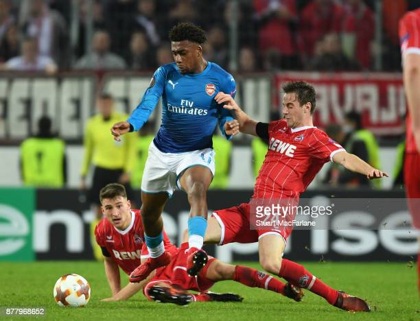 Alex Iwobi of Arsenal breaks past Lukas Klunter of Cologne during the UEFA Europa League group H match between FC Koln and Arsenal FC at...