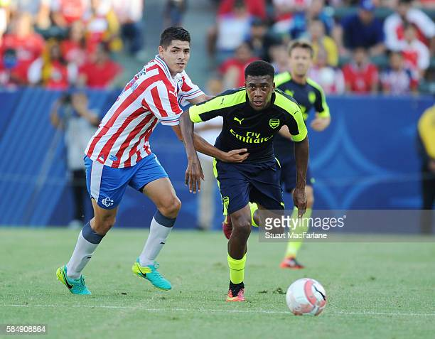 Alex Iwobi of Arsenal breaks past Orbelin Pineda of Chivas during the pre season friendly match between Arsenal and CD Guadalajara at StubHub Center...