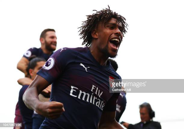 Alex Iwobi of Arsenal celebrates after his team's second goal during the Premier League match between Fulham FC and Arsenal FC at Craven Cottage on...
