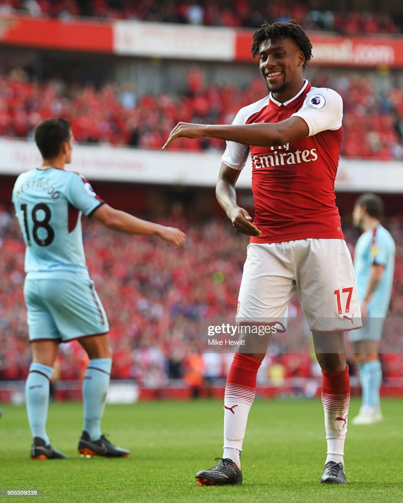 Alex Iwobi of Arsenal celebrates after scoring his sides fourth goal during the Premier League match between Arsenal and Burnley at Emirates Stadium on May 6, 2018 in London, England.
