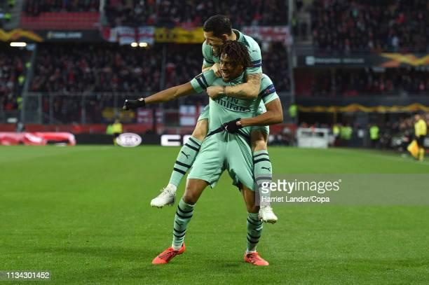 Alex Iwobi of Arsenal celebrates after scoring his team's first goal during the UEFA Europa League Round of 16 First Leg match between Stade Rennais...