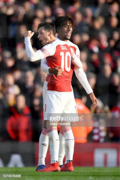 Alex Iwobi of Arsenal celebrates after scoring his team's third goal with Mesut Ozil of Arsenal during the Premier League match between Arsenal FC...