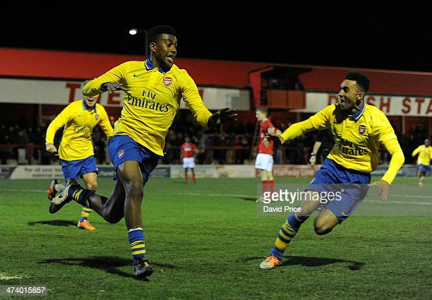 Alex Iwobi of Arsenal celebrates after scoringtheir first goal with teammate Chuba Akpom during the FA Youth Cup 5th Round match between Charlton...