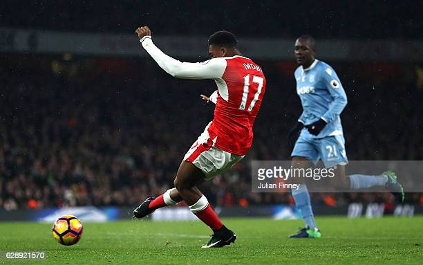 Alex Iwobi of Arsenal celebrates scoring his sides third goal during the Premier League match between Arsenal and Stoke City at the Emirates Stadium...