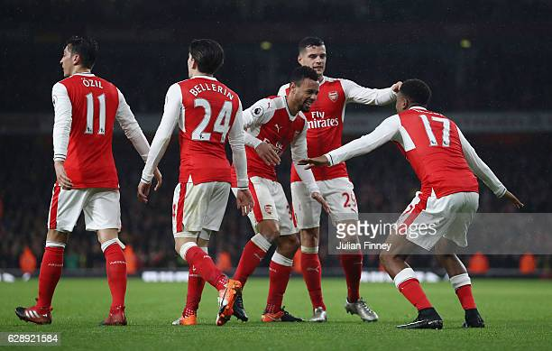 Alex Iwobi of Arsenal celebrates scoring his sides third goal with his Arsenal team mates during the Premier League match between Arsenal and Stoke...