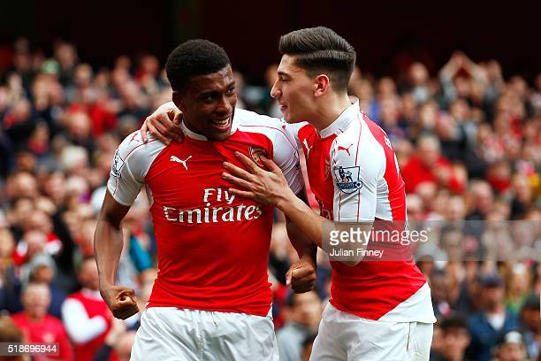 Alex Iwobi of Arsenal celebrates scoring his team's second goal with his team mate Hector Bellerin during the Barclays Premier League match between...