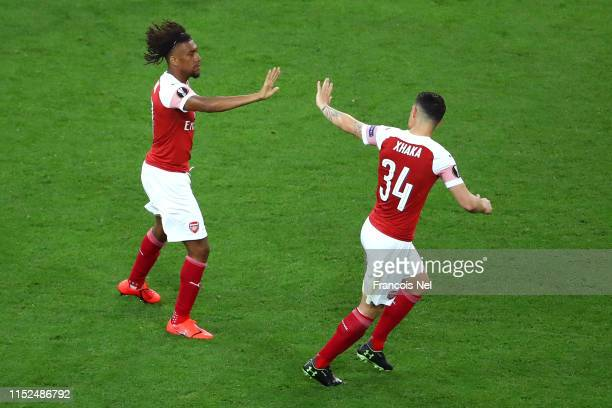 Alex Iwobi of Arsenal celebrates with teammate Granit Xhaka after scoring his team's first goal during the UEFA Europa League Final between Chelsea...
