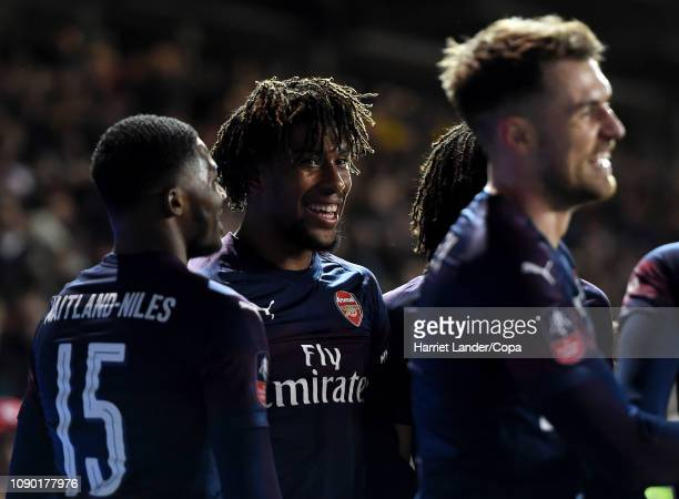 Alex Iwobi of Arsenal celebrates with teammates after scoring his team's third goal during the FA Cup Third Round match between Blackpool and Arsenal...