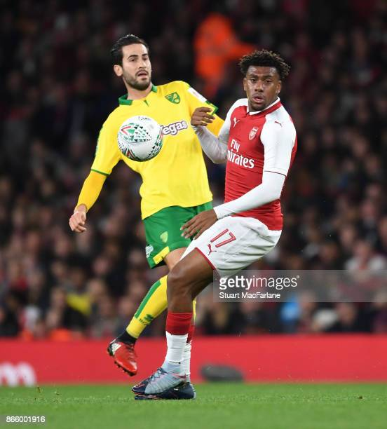 Alex Iwobi of Arsenal challenged by Mario Vrancic of Norwich during the Carabao Cup Fourth Round match between Arsenal and Norwich City at Emirates...