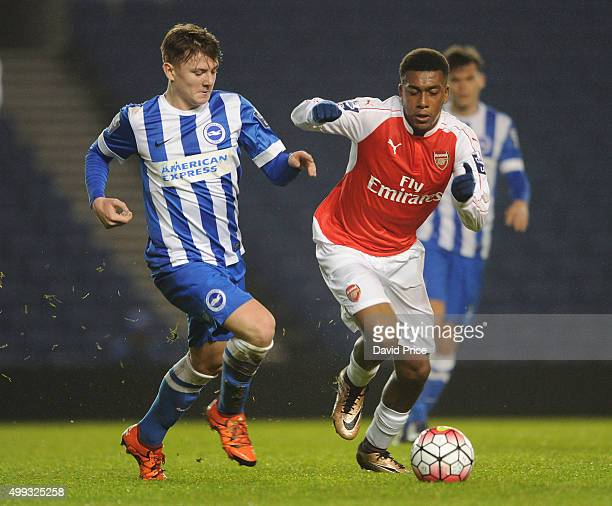 Alex Iwobi of Arsenal challenges James Tilley of Brighton during the match between Brighton and Hove Albion U21 and Arsenal U21 at Amex Stadium on...