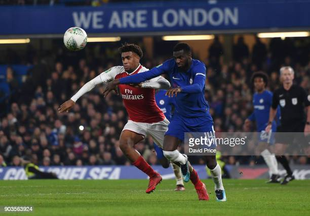 Alex Iwobi of Arsenal challenges Tiemoue Bakayoko of Chelsea for the ball during the Carabao Cup Semie Final 1st leg match between Chelsea and...