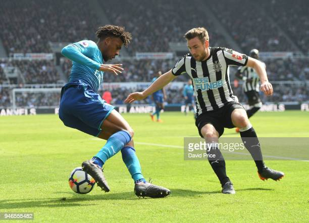 Alex Iwobi of Arsenal cuts inside Paul Dummett of Newcastle during the Premier League match between Newcastle United and Arsenal at St James Park on...