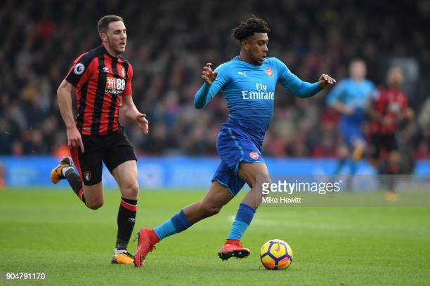 Alex Iwobi of Arsenal gets away from Dan Gosling of AFC Bournemouth during the Premier League match between AFC Bournemouth and Arsenal at Vitality...