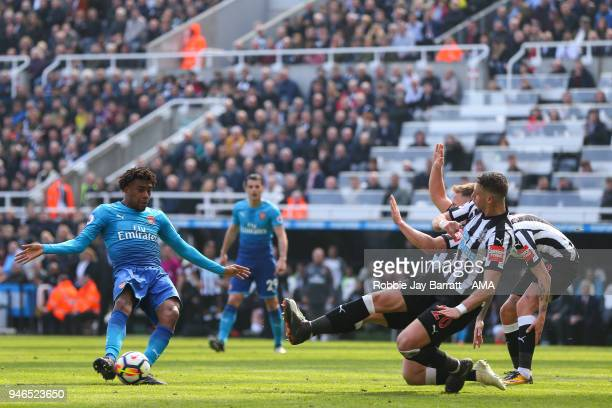 Alex Iwobi of Arsenal has as shot blocked during the Premier League match between Newcastle United and Arsenal at St James Park on April 15 2018 in...