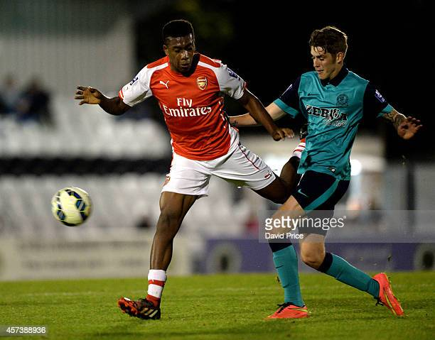 Alex Iwobi of Arsenal is challenged by Connor Mahoney of Blackburn during the match between Arsenal U21 and Blackburn U21 in the Barclays Premier U21...