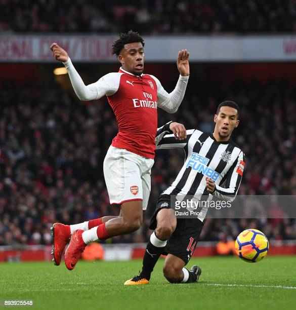 Alex Iwobi of Arsenal is challenged by Isaac Hayden of Newcastle during the Premier League match between Arsenal and Newcastle United at Emirates...