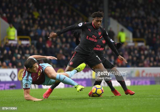 Alex Iwobi of Arsenal is challenged by James Tarkowski of Burnley during the Premier League match between Burnley and Arsenal at Turf Moor on...