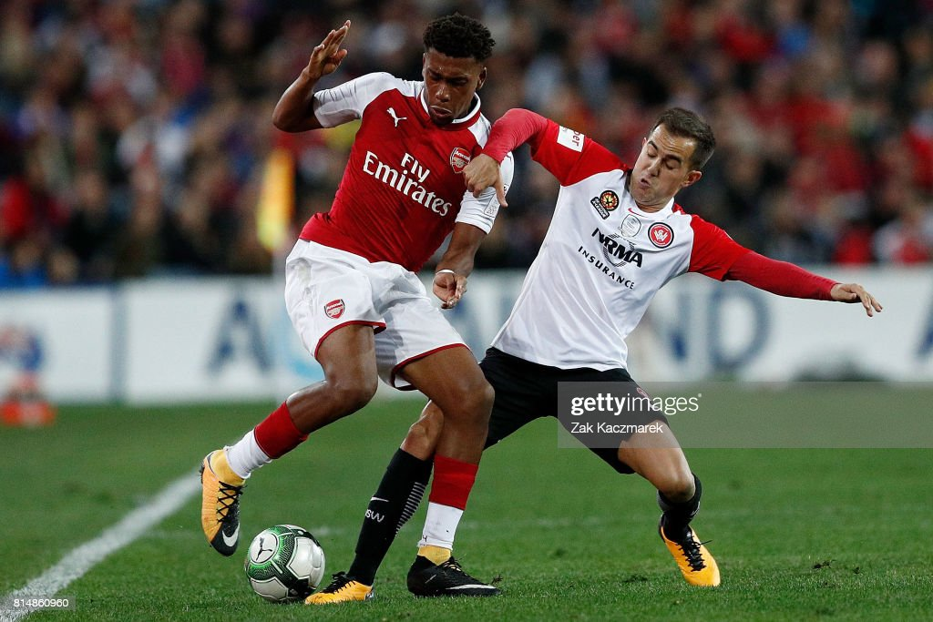Alex Iwobi of Arsenal is challenged by Steve Lustica of the Wanderers during the match between the Western Sydney Wanderers and Arsenal FC at ANZ Stadium on July 15, 2017 in Sydney, Australia.