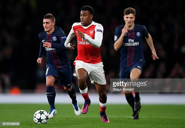 Alex Iwobi of Arsenal is chased by Marco Verratti of PSG during the UEFA Champions League Group A match between Arsenal FC and Paris SaintGermain at...
