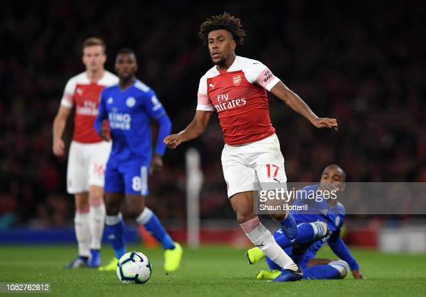Alex Iwobi of Arsenal is tackled by Ricardo Pereira of Leicester City during the Premier League match between Arsenal FC and Leicester City at...